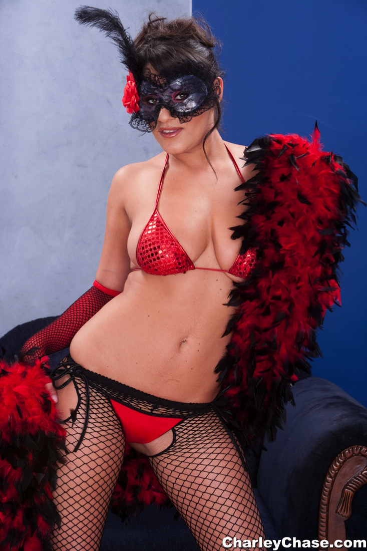 Charley wears a red corset and stockings