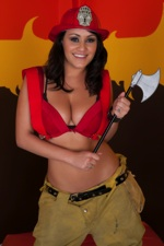 Pornstar Charley Chase strips out of a Fire Fighter suit to show off her big tits.